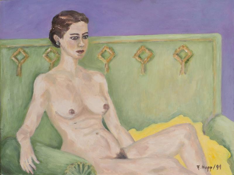 Sitzender Akt auf grünem Sofa