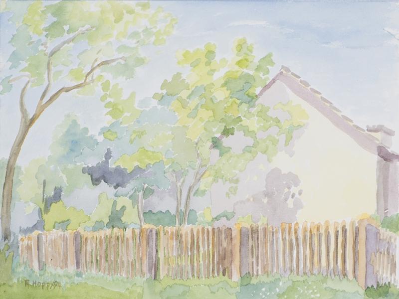 Haus hinterm Zaun